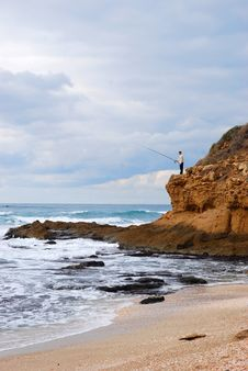 Free Fisherman On A Rock Stock Photos - 7896913
