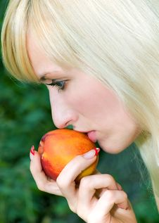 Girl With The Peach Stock Photo