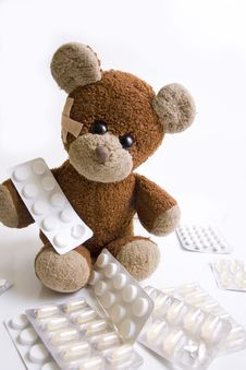 Sick Teddy Bear With Pills. Royalty Free Stock Photo