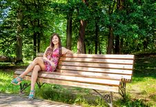 Free Young Beautiful Girl Sitting On A Park Bench Royalty Free Stock Photos - 78934588