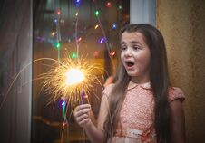 Free Little Girl Holding A Sparkler Royalty Free Stock Photo - 78935105