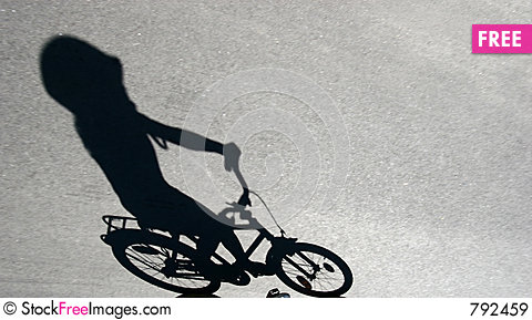 Free Shade Of Child On A Bike Royalty Free Stock Images - 792459