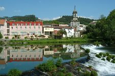 Free Village Reflected In The River With Cascade Stock Photography - 793042
