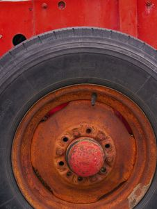 Free Old Tire And Wheel Painted A Bright Red Royalty Free Stock Photos - 796938