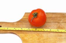 Free Measuring A Tomato Royalty Free Stock Photography - 799307