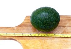 Measuring An Avocado Royalty Free Stock Images