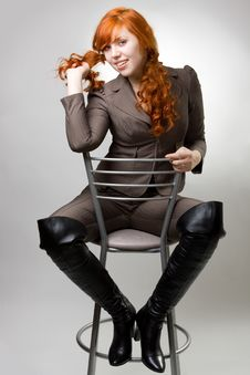 Free Red-haired Girl On A Chair Stock Image - 7901571