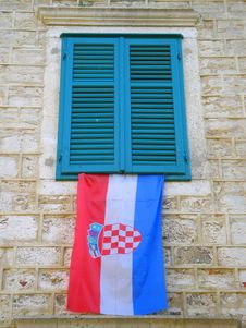 A Wall With Window & Croatian Flag Royalty Free Stock Image