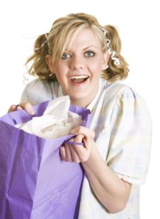 Free Humorous Girl In Pigtails And Pajamas Gets Gift Royalty Free Stock Photo - 7903075