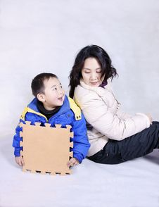 A Boy With His Mother. Stock Images