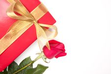 Free Gift With Gold Ribbon And Rose On White Royalty Free Stock Photo - 7905575
