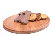 Wafers And Cookie Lie On The Round Board. Royalty Free Stock Image