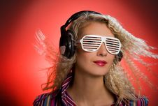 Woman With Shutter Glasses And Headphones Stock Photos
