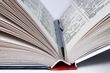 Open Book With A Ball Pen Inside Royalty Free Stock Photo