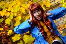 Woman In Blue Jaket Posing In Autumn Park Royalty Free Stock Photography
