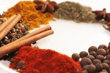 Spices On Glass Plate Royalty Free Stock Photos
