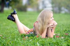 Free Woman Lying On A Green Grass Royalty Free Stock Photography - 7911967