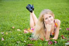 Free Woman Lying On A Green Grass Royalty Free Stock Image - 7911986