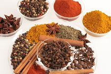 Spices In Small Glass Bowl And Plates Royalty Free Stock Image