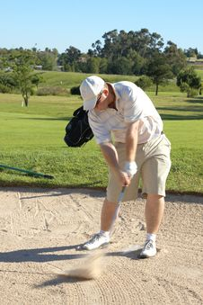 Free Golfer In The Sand Bunker Royalty Free Stock Image - 7912116