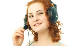 Free Happy Girl Wearing Earphones With A Microphone Royalty Free Stock Images - 7912779
