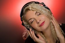 Woman Listening To The Music Stock Image