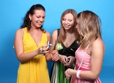 Three Female Friends With A Camera Royalty Free Stock Image