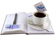 Coffee, Standing On Organizer,and  Diagrams. Royalty Free Stock Image