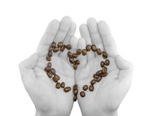 Coffee In Form Of Heart On Black -white Hands.
