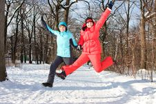 Two Cheerful Friendly Girls Jump In Park Stock Photography