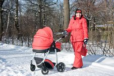 Free Young Woman In Red With Red Baby Carriage Royalty Free Stock Image - 7915666