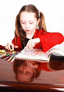 Little Girl Coloring. Royalty Free Stock Image