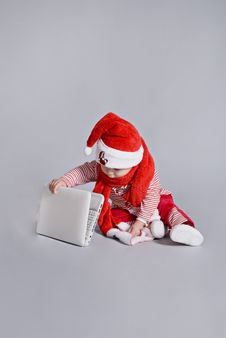 Baby Santa Claus With White Laptop Royalty Free Stock Image