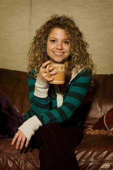 Free Young Woman Enjoying Hot Chocolate Royalty Free Stock Photography - 7919917
