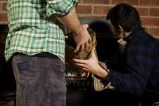 Free Man Giving His Friend A Log Royalty Free Stock Photo - 7919945