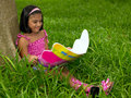Free Girl Reading A Book In The Park Stock Images - 7920964