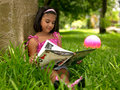 Free Girl Reading A Book In The Park Stock Image - 7921241