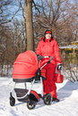 Free Young Woman In Red With Red Baby Carriage Royalty Free Stock Photo - 7927815