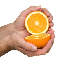 Free Hand Holding Halves Of Orange Royalty Free Stock Image - 7920306