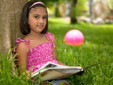 Free Girl Reading A Book In The Park Royalty Free Stock Image - 7921226