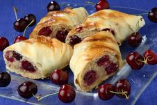 Rolled Pastry With Cherries Royalty Free Stock Photography