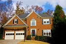 Free Brick House With Christmas Wreaths Stock Images - 7924744