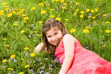 Free Girl Smiling In Front Of Flowers Royalty Free Stock Photography - 7927757