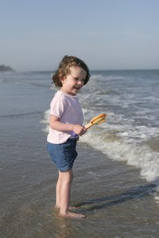 Free Little Girl Playing On Beach Stock Image - 7927781