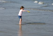 Free Little Girl Playing On Beach Stock Photography - 7927792