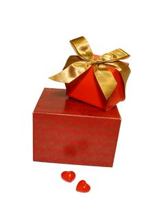 Two Red Gifts With A Gold Ribbon And Two Hearts Royalty Free Stock Image