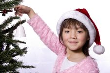 Free Girl Holds Bell Next To Tree. Stock Photography - 7928722