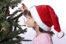 Free Girl Kisses Bell Next To Tree. Royalty Free Stock Photo - 7928765