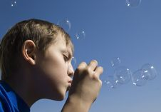 Free Boy Blowing Soap Bubbles Royalty Free Stock Images - 7929899