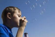 Free Boy Blowing Soap Bubbles Stock Image - 7929901